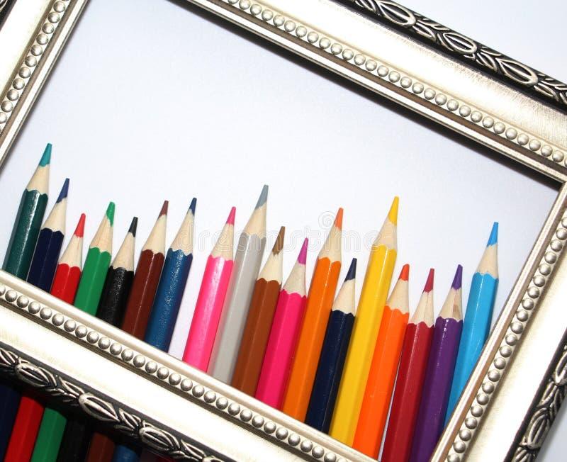绘画和色的铅笔的葡萄酒框架在白色背景 库存照片