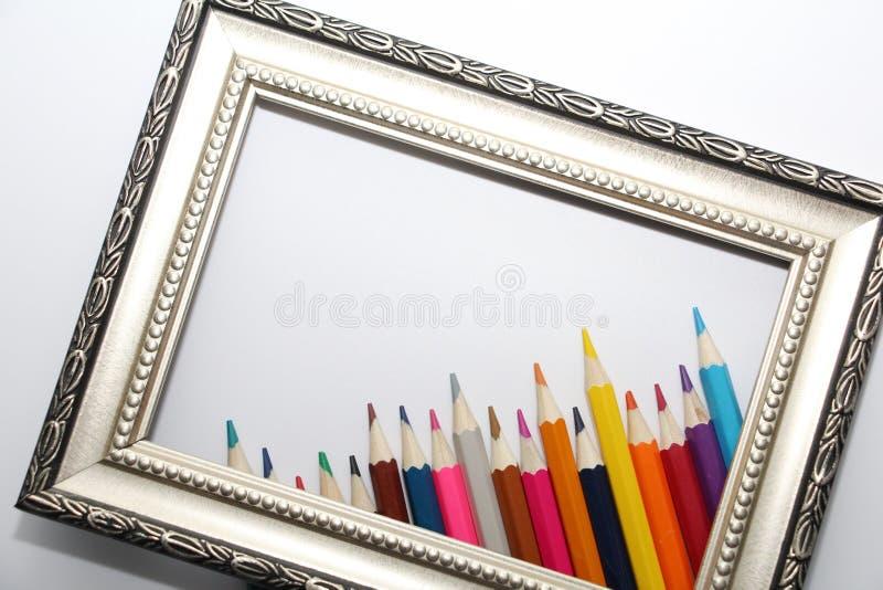 绘画和色的铅笔的葡萄酒框架在白色背景 免版税库存照片