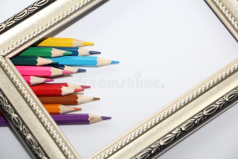 绘画和色的铅笔的葡萄酒框架在白色背景 图库摄影