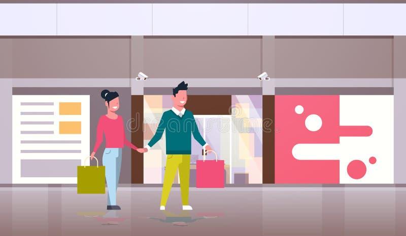 结合拿着走在现代商店购物中心中心外部前面的购物带来大销售概念愉快的人妇女 皇族释放例证