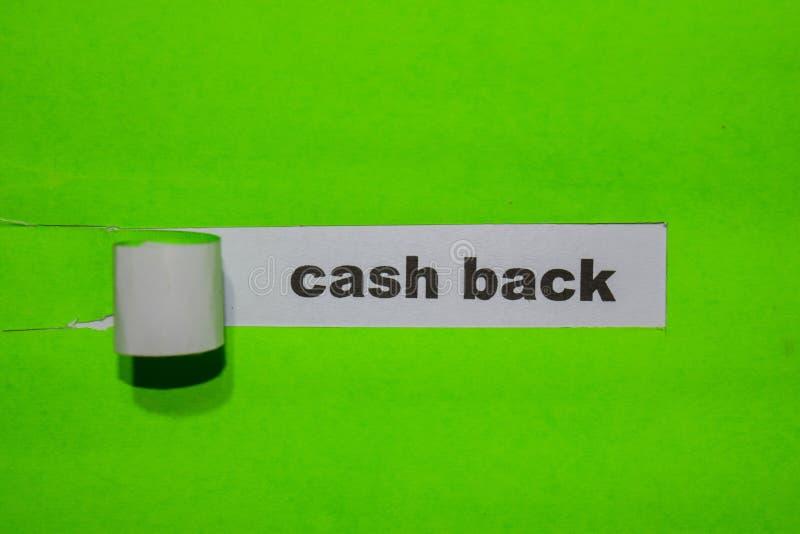 现金后面、启发和企业概念在绿色被撕毁的纸 免版税库存照片