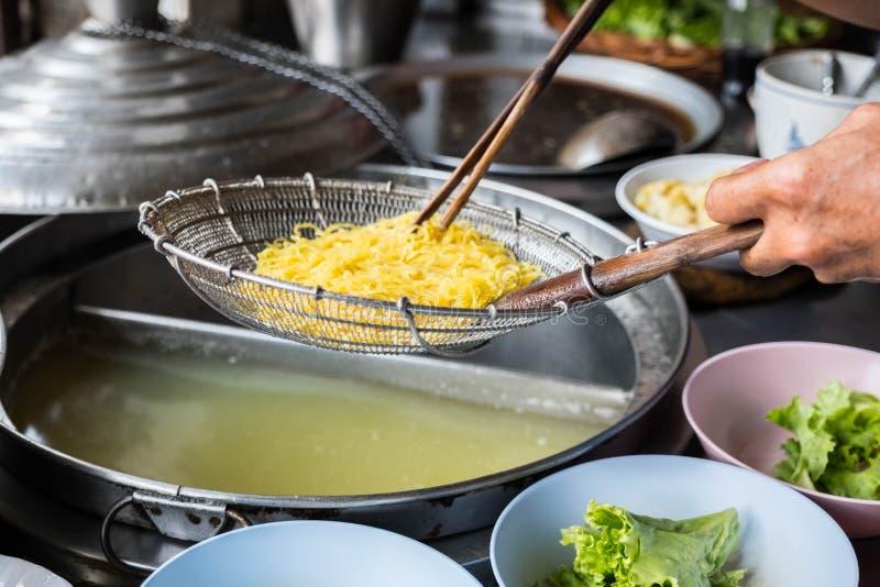 烹调在泰国的中国面条 免版税图库摄影