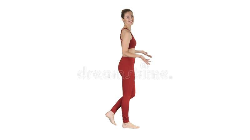 瑜伽教练员谈话与在白色背景的照相机 免版税库存照片