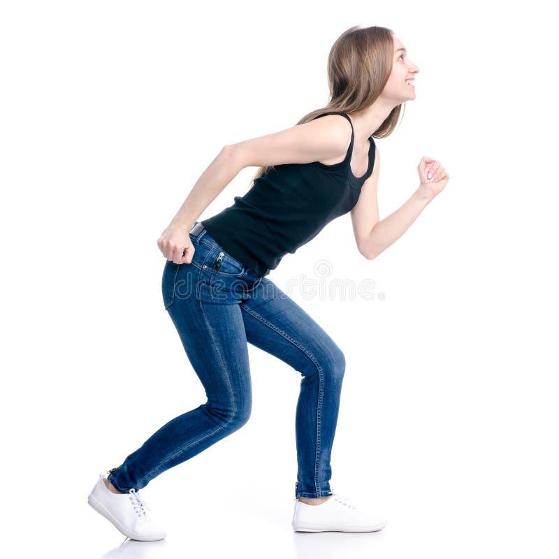 牛仔裤走的妇女去跑 免版税库存图片