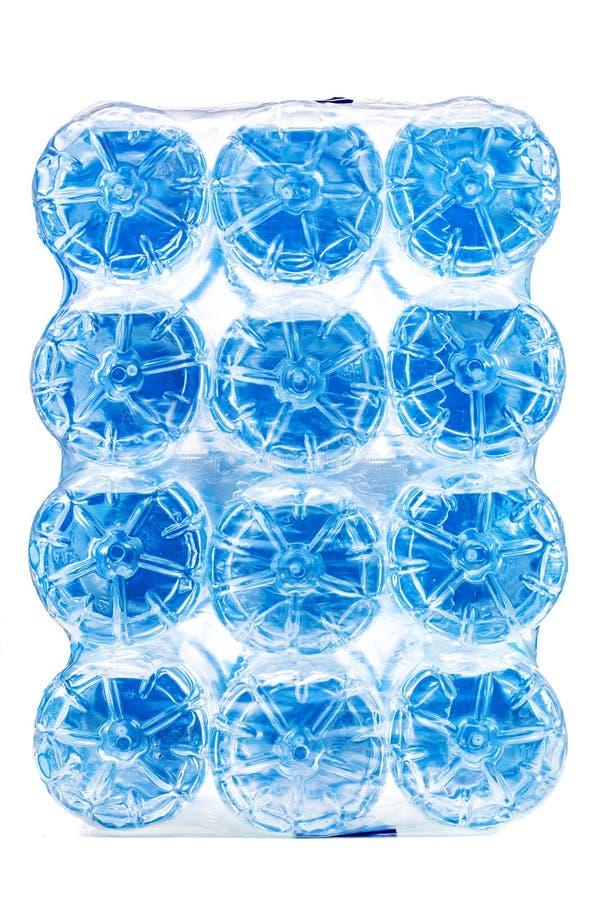 盒十二个塑料水瓶 图库摄影
