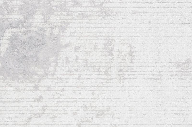 白色墙板的难看的东西,浅灰色的混凝土有轻的背景 肮脏,尘土白色墙壁具体背景纹理和飞溅或者a 免版税库存照片
