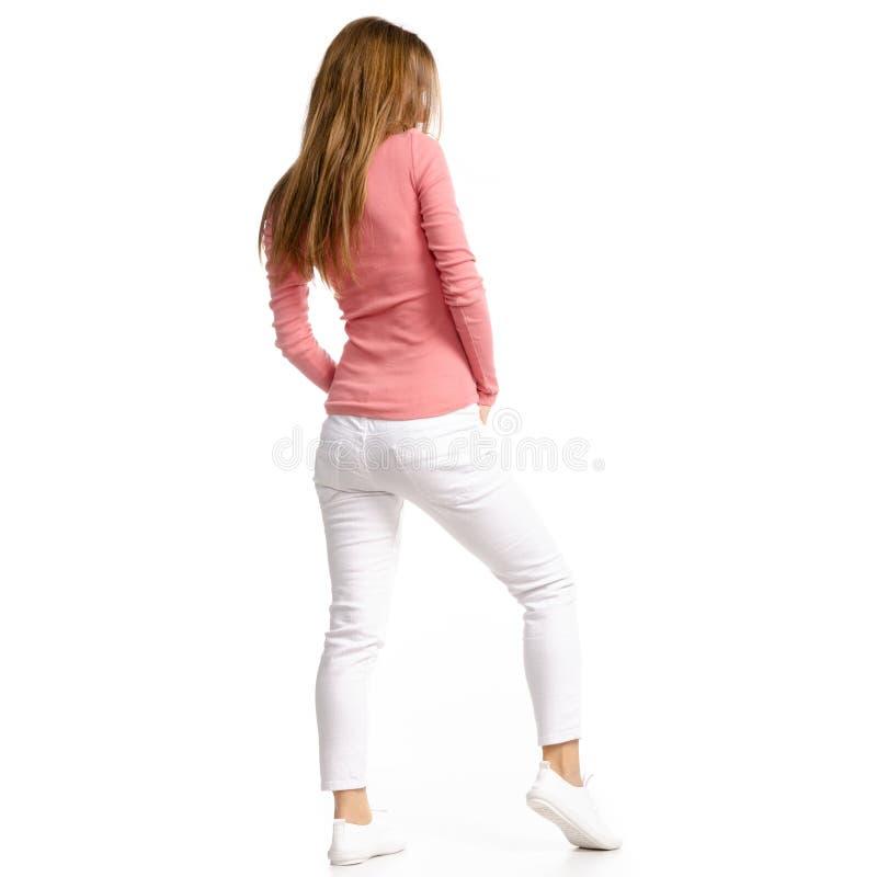 白色牛仔裤和衬衣的妇女 免版税库存图片