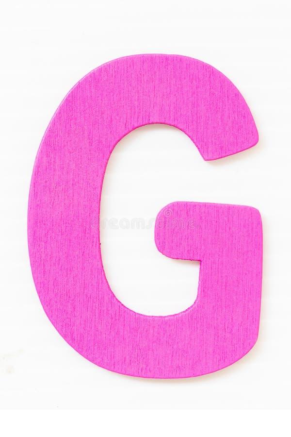 紫色木在白色背景G隔绝的字母表大写字母 免版税图库摄影