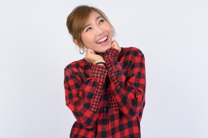 画象年轻愉快亚洲行家妇女认为 免版税图库摄影