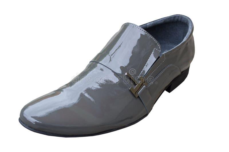 被涂清漆的鞋子,在白色背景的一个被上漆的人的鞋子 库存图片