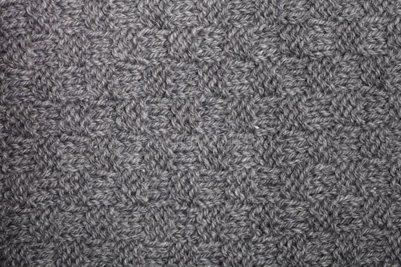 被编织的灰色围巾纹理 免版税库存照片