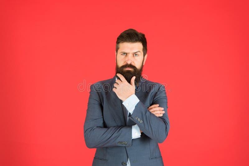解决问题的人有胡子的商人周道的面孔做出决定 政策制定是管理的一部分 精神 免版税图库摄影