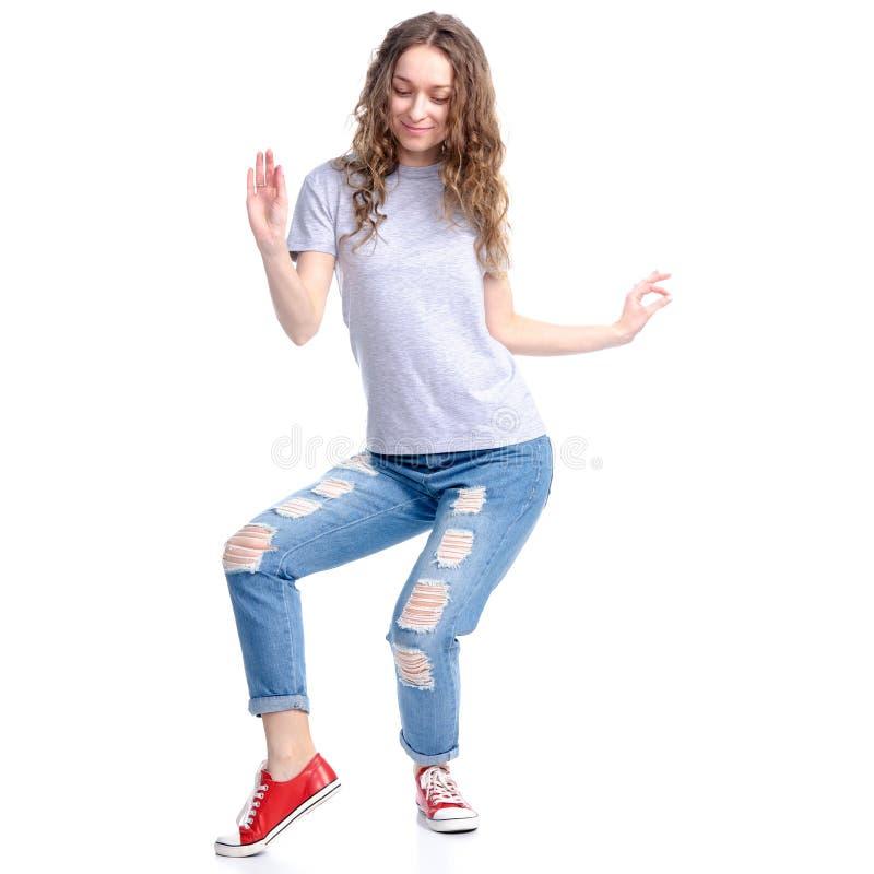 跳舞微笑的牛仔裤的妇女 库存图片