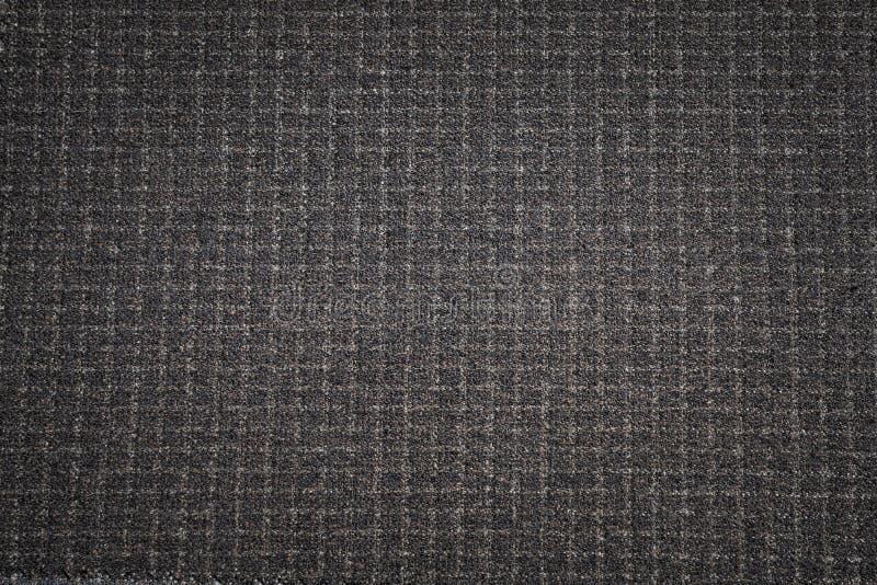 背景黑色织品纹理 黑暗的被编织的衣物材料 免版税库存照片
