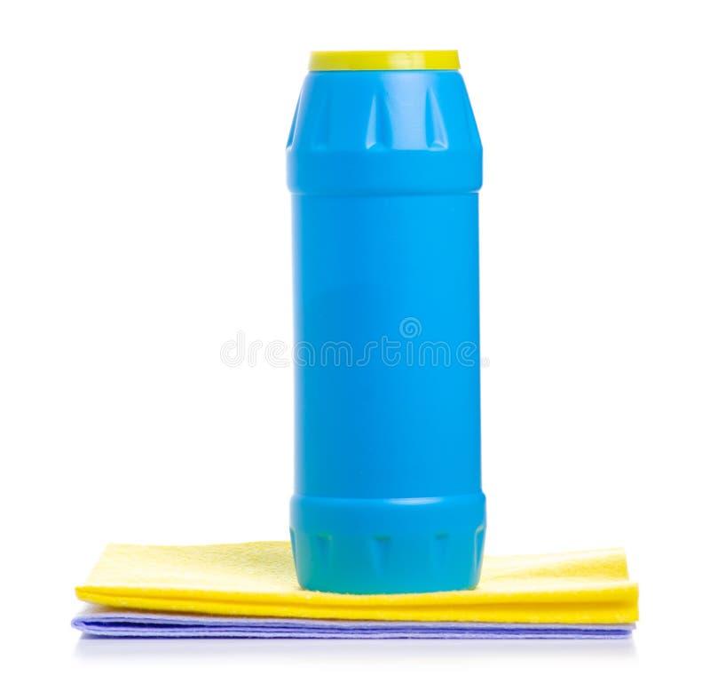 蓝色瓶洗涤剂粉末和干净的旧布 图库摄影