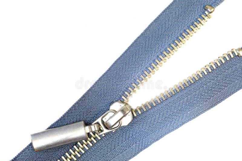 蓝色金属缝合的拉链解扣了 免版税库存图片