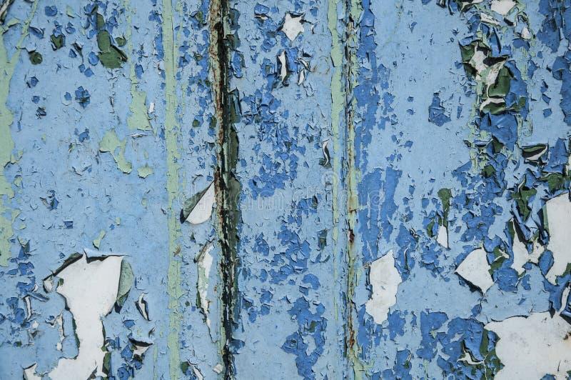 老油漆金属铁锈纹理  背景是蓝色,带红色和浅绿色的 铁腐蚀 免版税库存照片