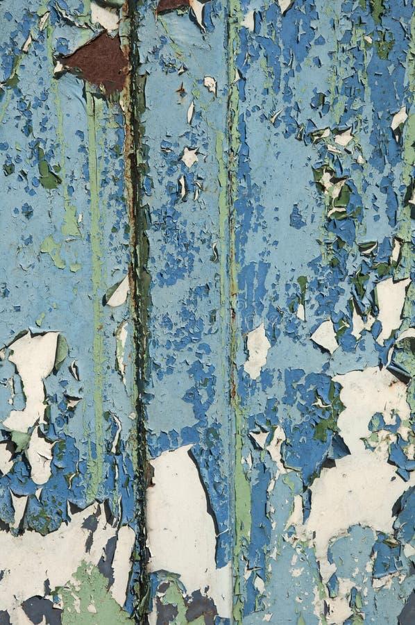 老油漆金属铁锈纹理  背景是蓝色,带红色和浅绿色的 铁腐蚀 免版税库存图片