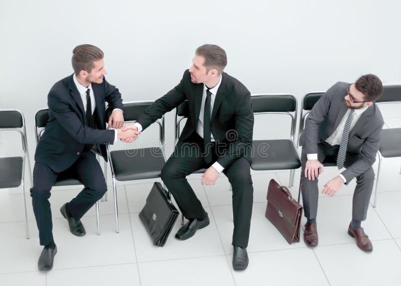 顶视图 招呼企业的同事与握手 库存图片