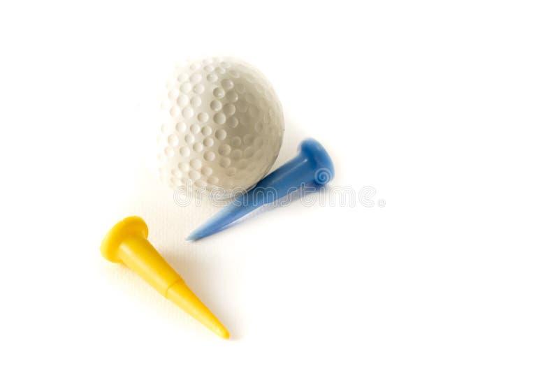 高尔夫球和发球区域在白色背景 库存图片