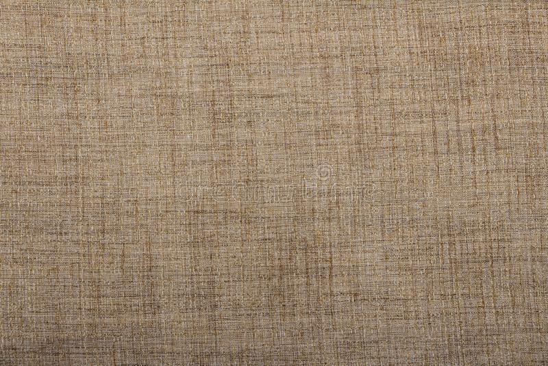 黑森州的麻袋布粗麻布被编织的纹理背景/棉花机织织物背景与灰棕色和眉头的变化的颜色斑点  免版税库存图片
