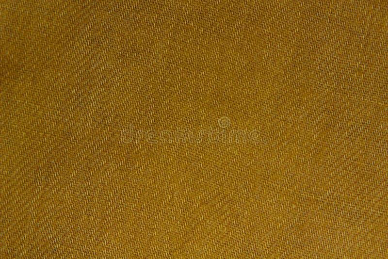 黄色亚麻制织品纹理 库存图片