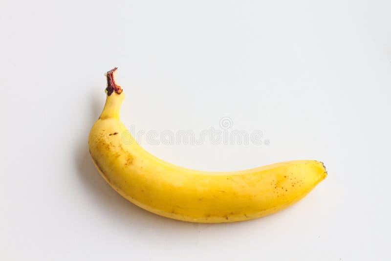 Één banaan op een witte achtergrond royalty-vrije stock afbeeldingen