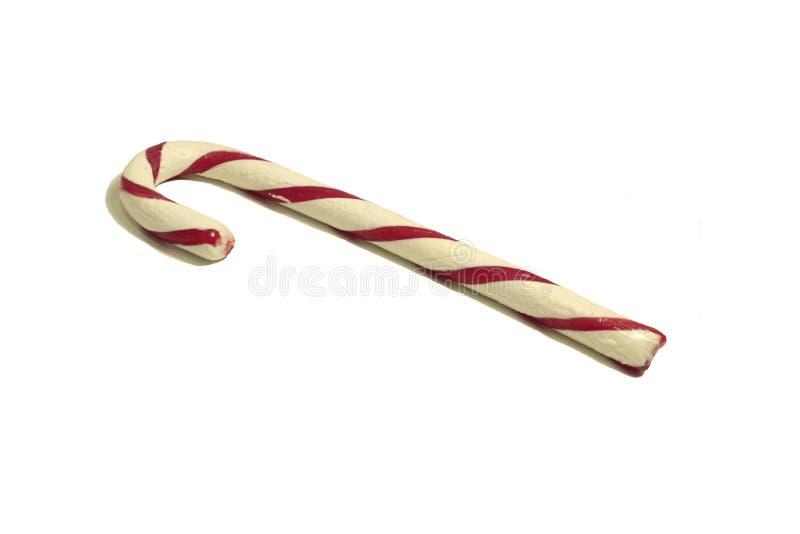 Één enkel rood en wit gestreept die suikergoedriet op wit wordt geïsoleerd royalty-vrije stock afbeelding