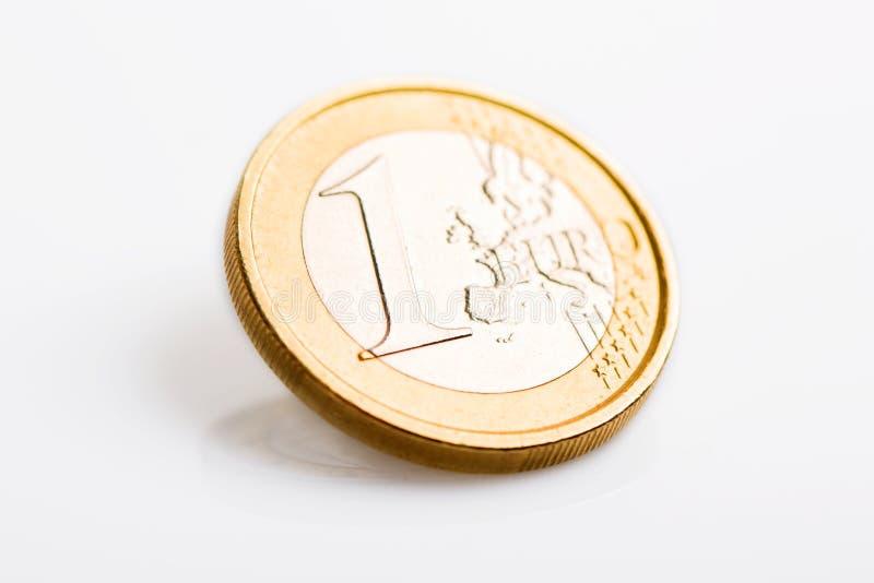 Één euro geïsoleerd muntstuk stock foto's