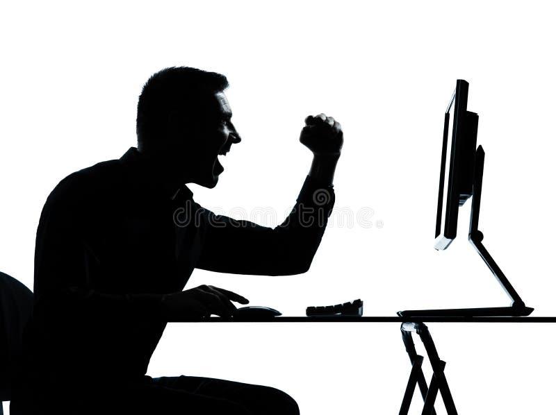 Één gelukkige computer van het bedrijfsmensensilhouet royalty-vrije stock afbeelding