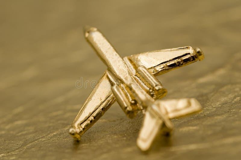 Één Gouden Vliegtuig stock fotografie