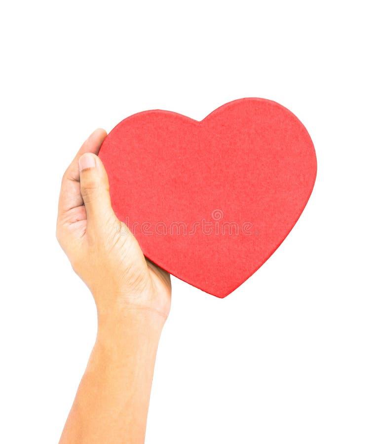 Één hand die rood hart gevormd doosdeksel, liefde, healthcar zorg houden, stock afbeelding