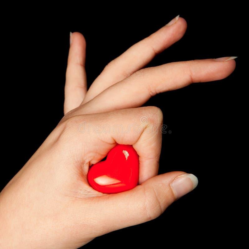 Één hart in haar hand royalty-vrije stock afbeeldingen