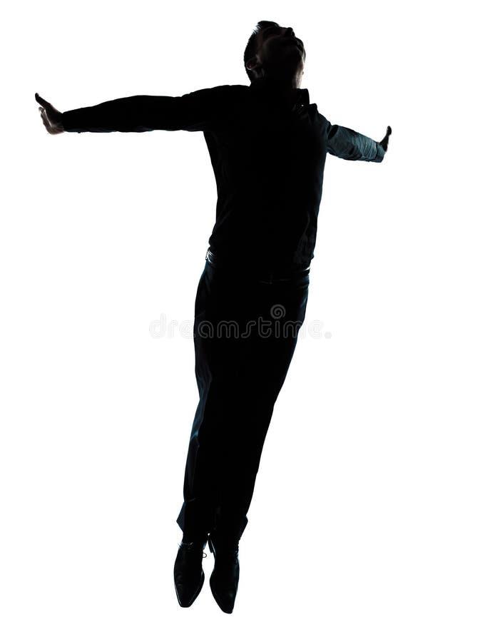 Één het bedrijfsmens springen vliegend silhouet stock afbeeldingen