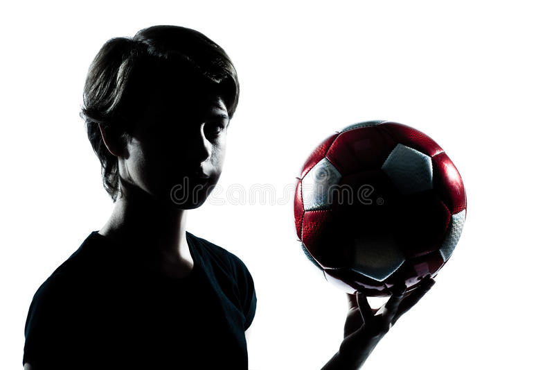 Één holding die van het het meisjessilhouet van de tienerjongen voetbalfootba tonen royalty-vrije stock foto