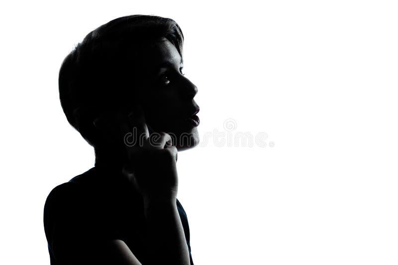Één jong tienerjongen of meisje op de telefoon stock fotografie