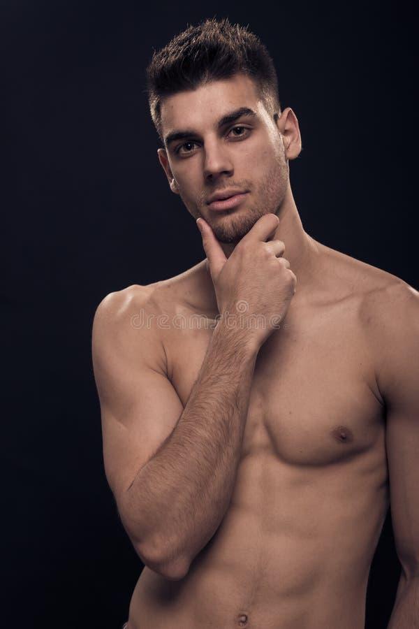 Één jonge mens, shirtless abs het gezichtshoofd van de lichaamshand royalty-vrije stock afbeelding