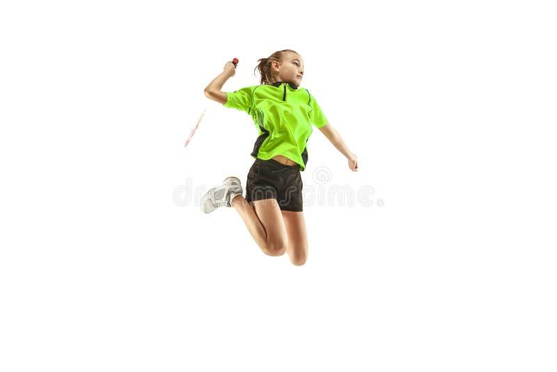 Één Kaukasische jonge speler van het de vrouwen speeldieBadminton van het tienermeisje op witte achtergrond wordt geïsoleerd stock foto's