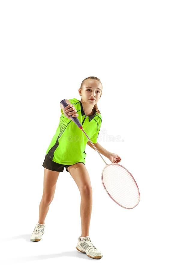 Één Kaukasische jonge speler van het de vrouwen speeldieBadminton van het tienermeisje op witte achtergrond wordt geïsoleerd stock fotografie