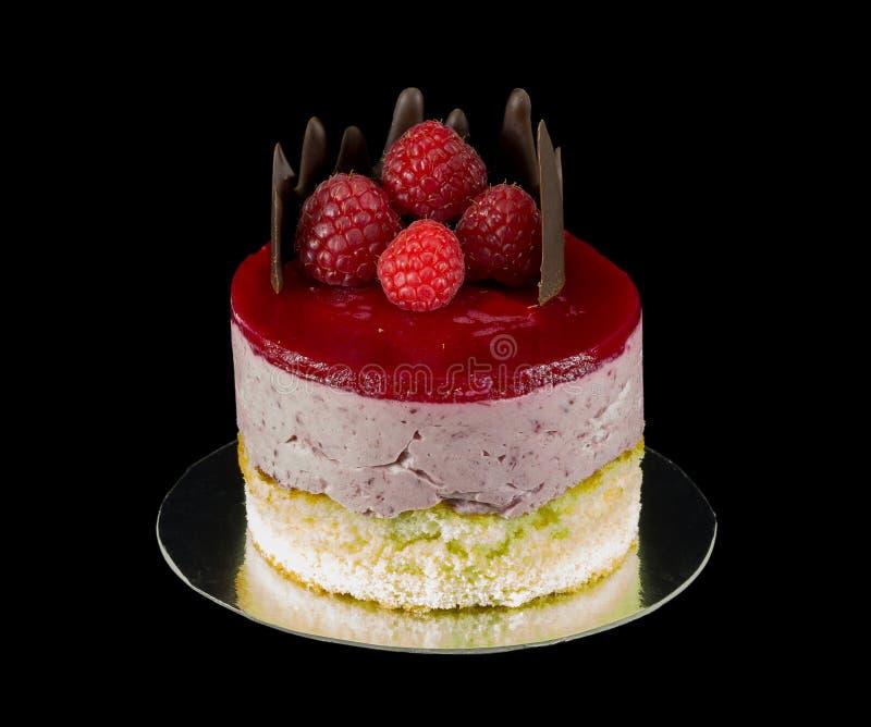 Één kleine cake met chocolade en frambozen royalty-vrije stock fotografie
