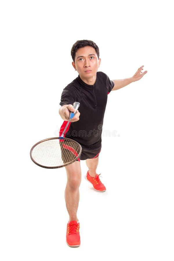 Één mannelijke Aziatische badmintonspeler in een gelijke stock fotografie