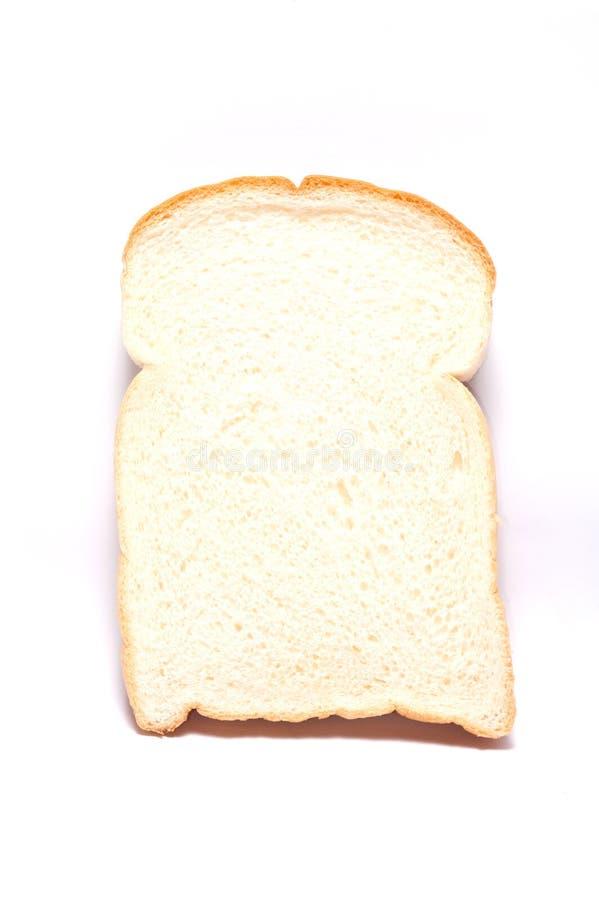 één plak van wit brood stock fotografie