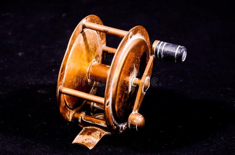 Één Uitstekende Oude Metaal Visserijspoel stock afbeeldingen