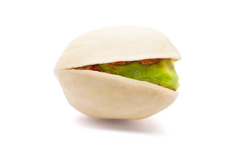 Één van pistache op witte achtergrond wordt geïsoleerd die stock fotografie