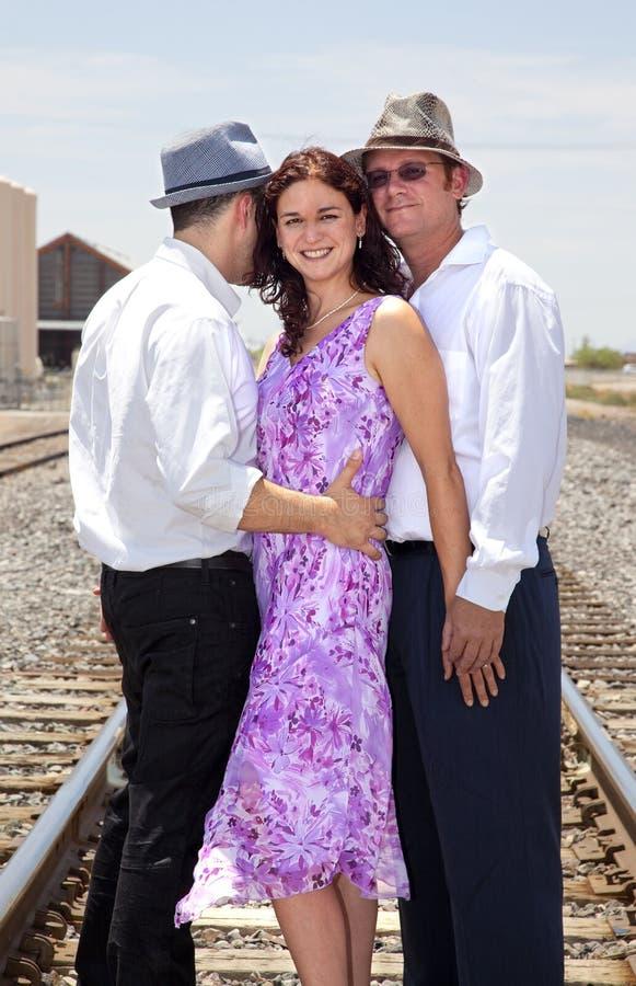 Één vrouw en twee mannen het omhelzen royalty-vrije stock foto
