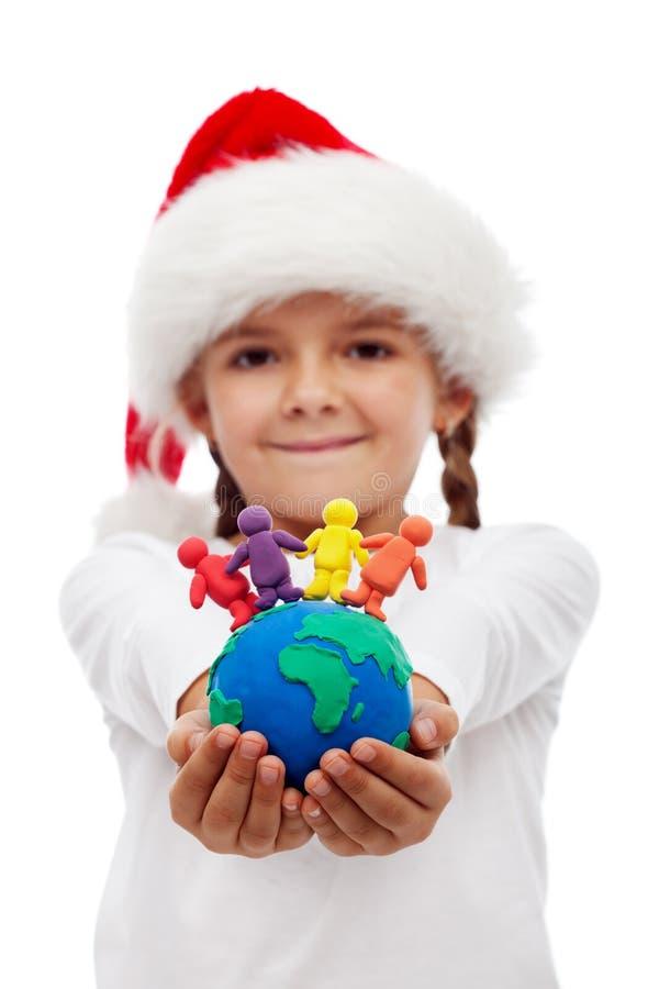 Één wereld van gelukkige mensen bij Kerstmisconcept royalty-vrije stock foto's