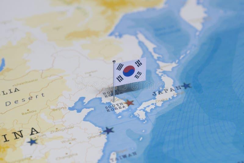 韩国的旗子世界地图的 库存图片