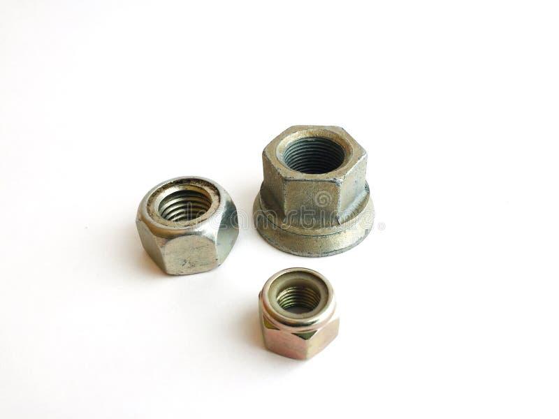 金属不同的大小六方形螺母  免版税库存图片