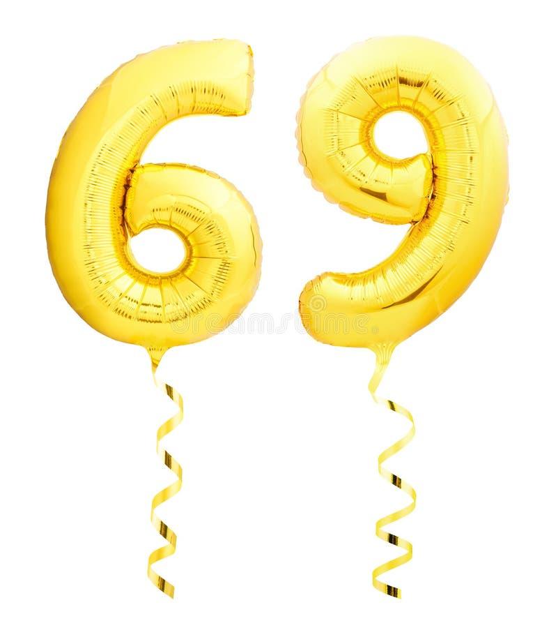 金黄第六十九69由有丝带的可膨胀的气球制成在白色 库存照片