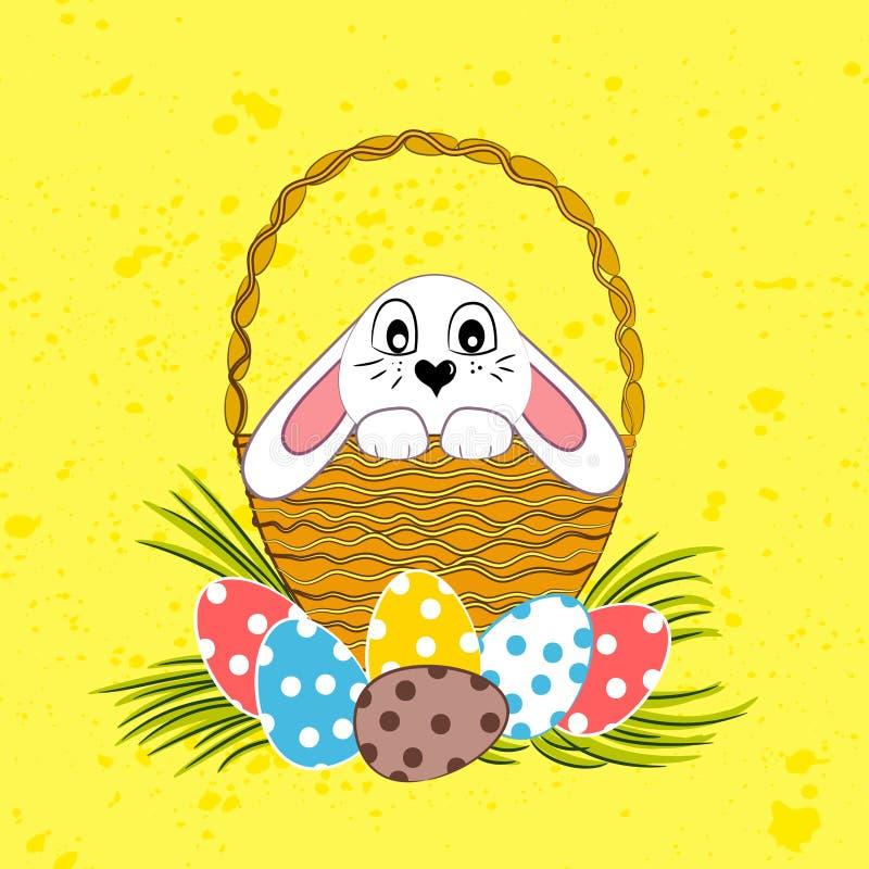 逗人喜爱的复活节兔子在篮子坐 皇族释放例证